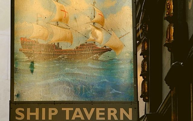 The Ship Tavern Holborn sign hanging by the entrance doorway